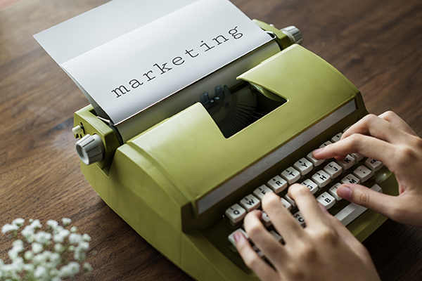 hands on a typewriter with words