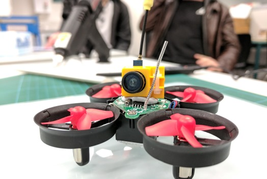 Mini Helicopter Drone with black, red and yellow plastic pieces