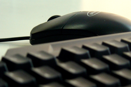 close up of a computer keyboard and mouse