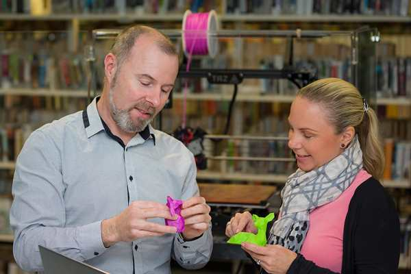 Two library staff with 3D printed objects