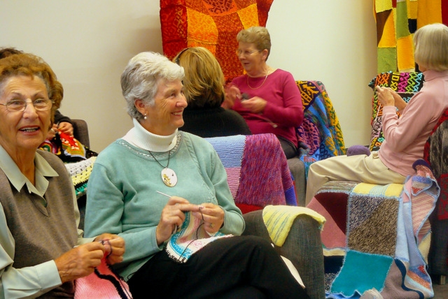 Group of ladies knitting for Wraps with Love