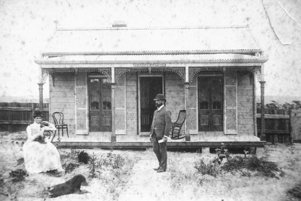 1910 to 1930 lady, gentleman, dog and stone cottage in Engadine.