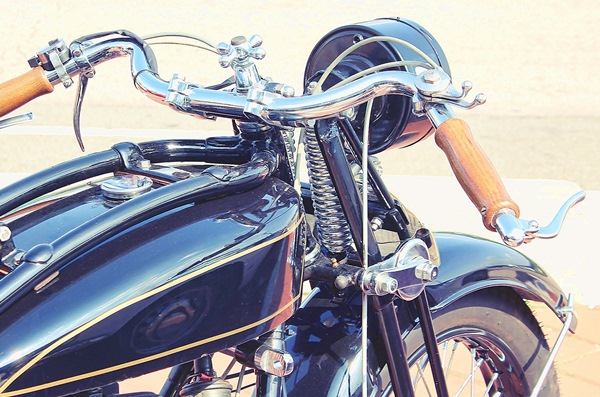 Classic black motorbike with wooden handles