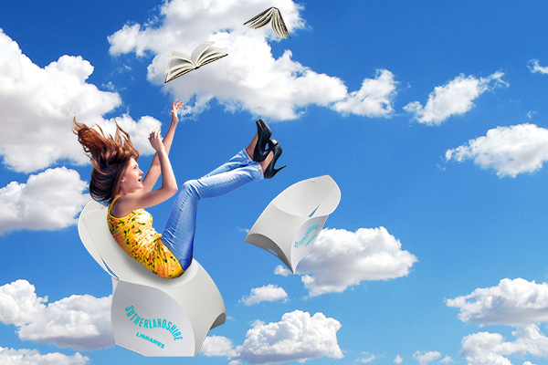 A young woman falling through blue, cloudy sky with branded chairs and books falling around her.