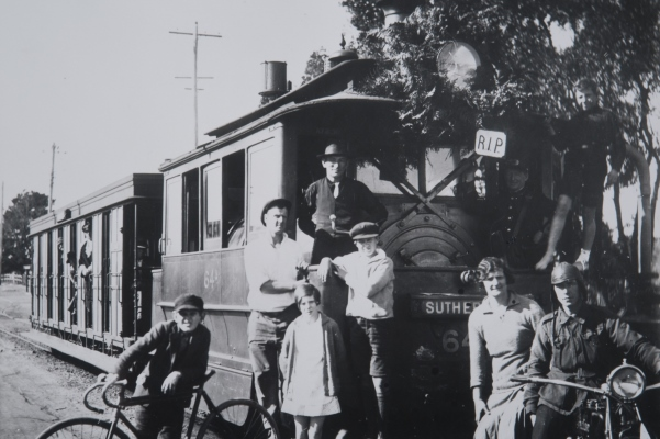 Black and white image with a family on a tram