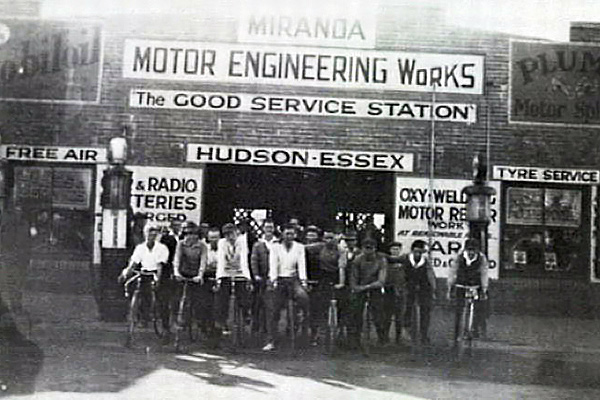 Sutherland Shire Bicycle Club members on their bicycles out front of the Miranda Motor Engineering Works, ca. 1927