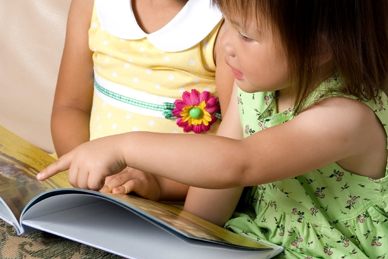 Two girls reading a picture book