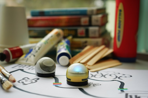 Ozobots maze, paint, craft supplies and books