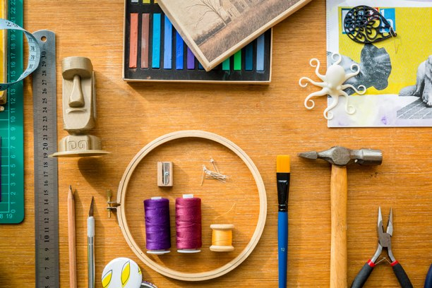 Rulers, thread, tools, pastels and 3D printed Easter Island head, octopus and earring