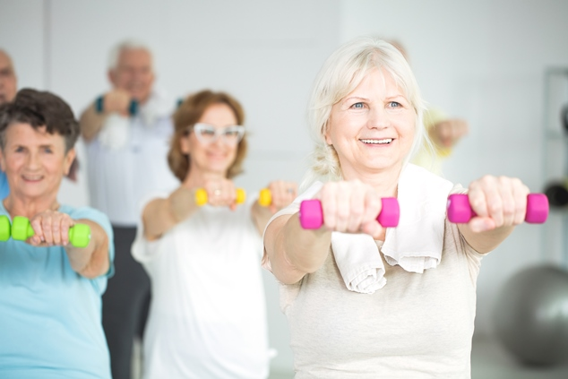 Older people exercising with had weights