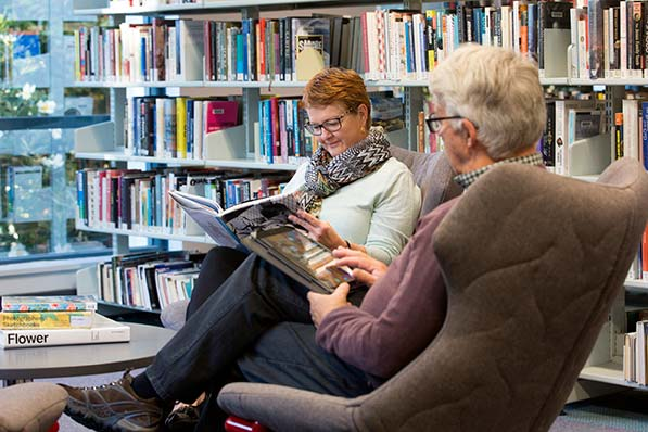 Older people reading at Sutherland Library