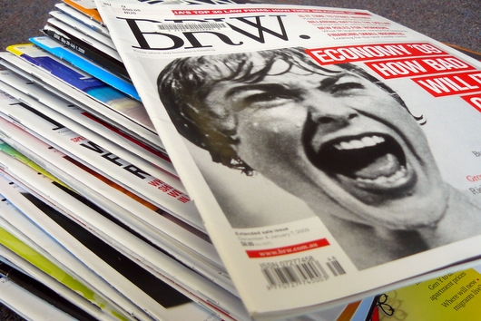large pile of magazine with Business Review Weekly on top