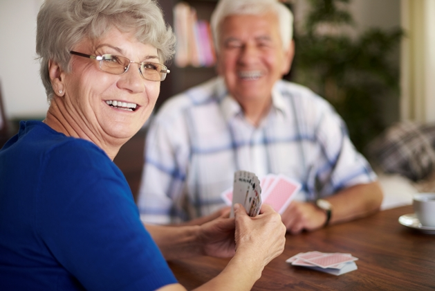 older people playing cards